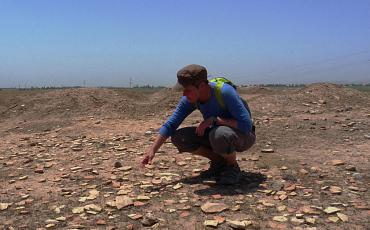 Isa inspecting some pottery chards at Jarqotan