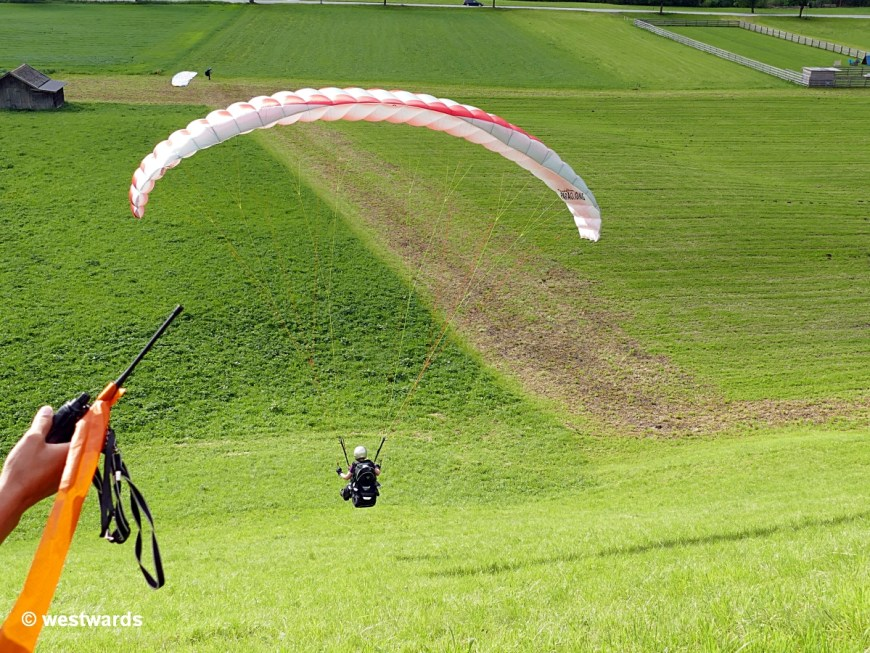 During the beginner's paragliding course, Isa is just so flying a few metres
