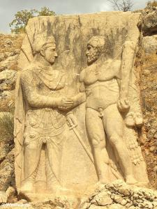 Stone relief in Arsameia / Mt Nemrut showing Mithridates I (with sword) and Heracles (naked)