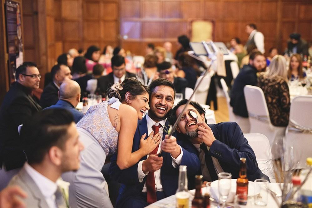 Selfie sticks are becoming very popular at weddings