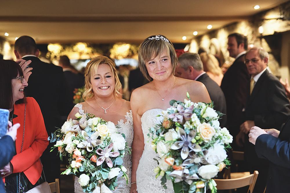 Brides walking out at Tower Hill Barns Wedding Venue