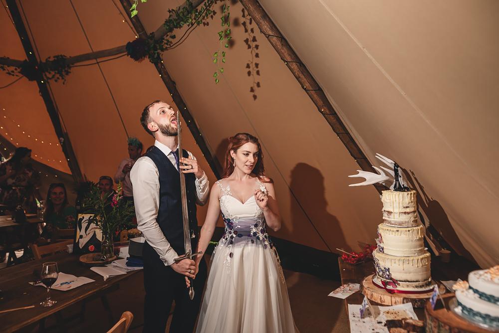 Cake cutting - Whitebottom Farm Wedding in Stockport