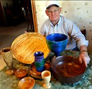 Bowl maker Wes Kolkmeier, 63, displays some his handywork at his home in St. Charles. Kolkmeier uses a variety of wood found in Missouri including walnut, sasafras, hackberry, elm and sycamore which are all represented here.