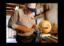 Bowl maker Wes Kolkmeier, 63, shaves the bowl with a 1/2-inch spindle gouge to finish the shape and smooth the finish.