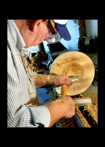 Wood shavings fly as bowl maker Wes Kolkmeier, 63, of St. Charles uses a 1/2-inch spindle gouge to hollow out the inside of the bowl as it turns on a lathe in his woodworking shop.