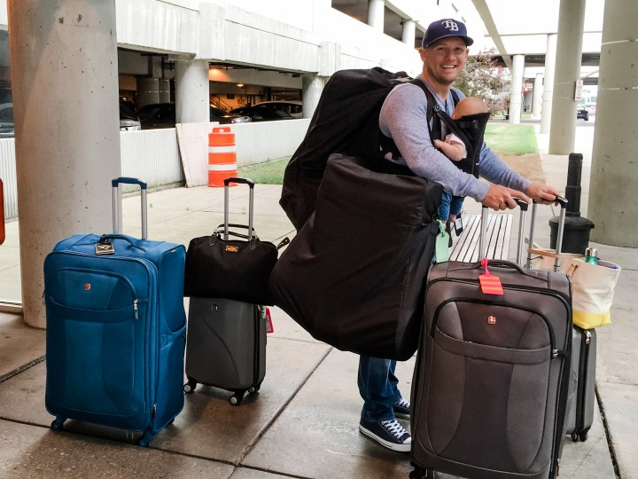 traveling with a baby overpacker lots of luggage dad