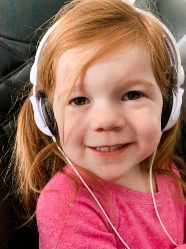 flying happy messy toddler face crumbs headphones