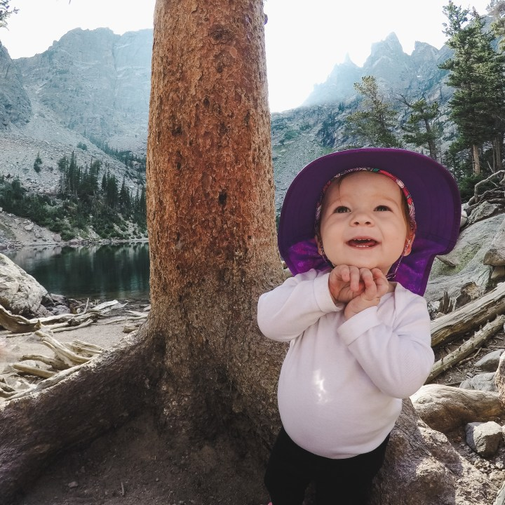 Little girl with sun hat at Emerald Lake in Rocky Mountain National Park, Colorado