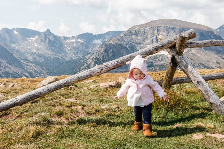 little girl walking playing in Alpine Tundra in Rocky Mountain National Park, Colorado