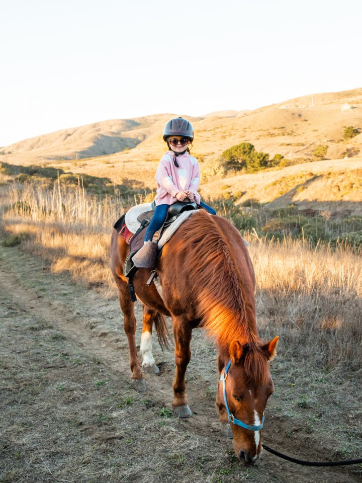 little girl horse back riding in Point Reyes, Northern California