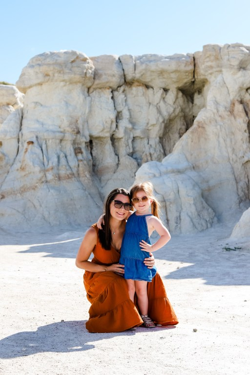 Woman and daughter at Paint Mines Interpretive Park in Calhan Colorado with sandstone rock formations.