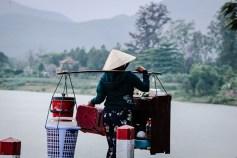 Vietnamese woman working at Hue: Thien Mu Pagoda