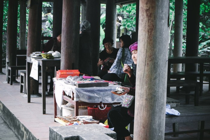 Vietnamese woman working at Tam Coc Bich Dong Pagoda