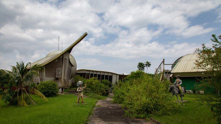 Dinosaur statues, film studio entrance