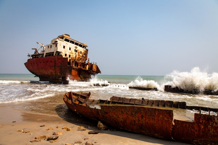 Angola travel blog highlighting the abandoned ships of the shipwreck beach.