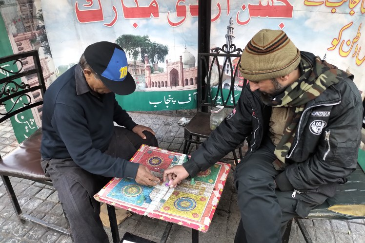 A game of Ludo in a cafe in Lahore, Pakistan.