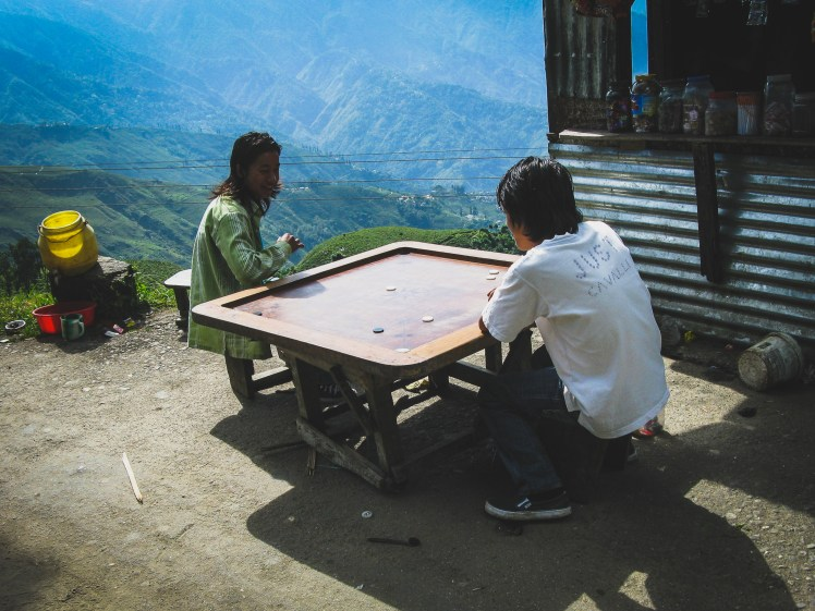 Mountaintop game of Carrom somewhere near Darjeeling, India.