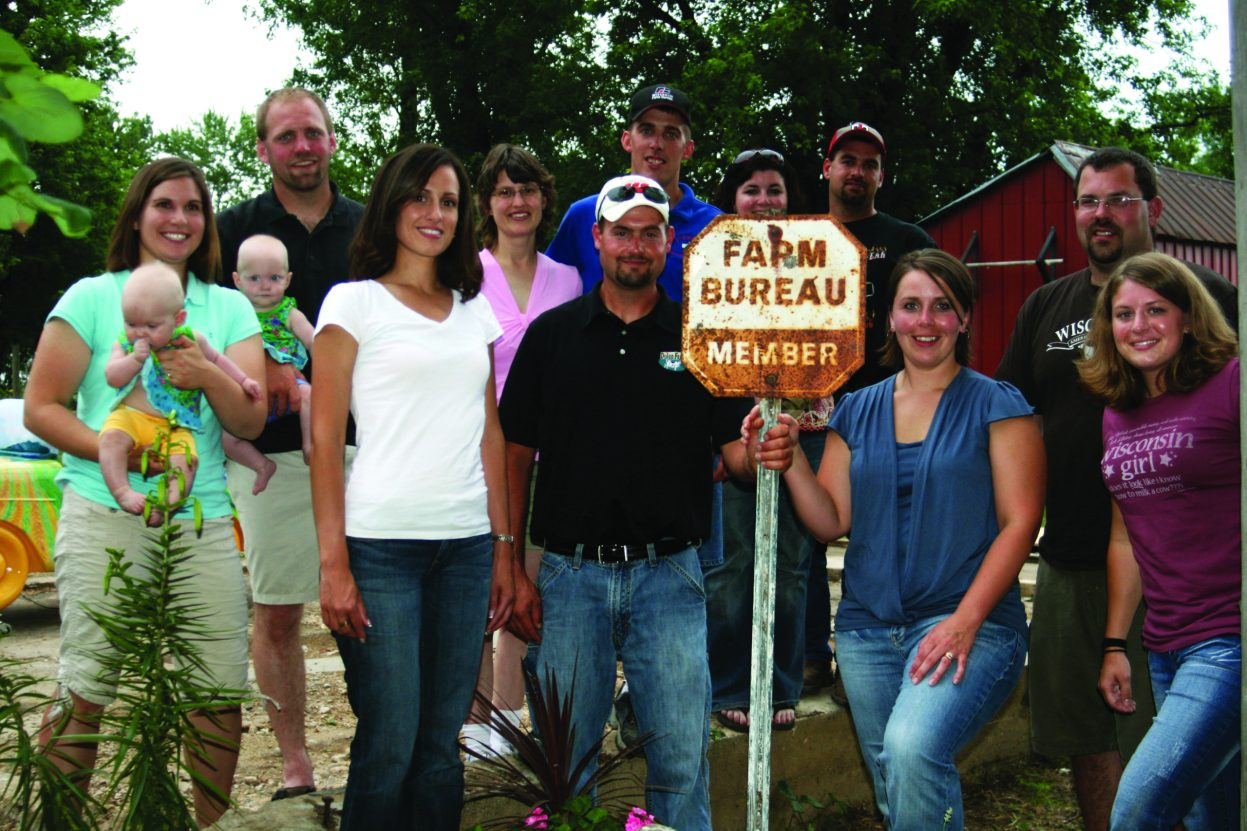 WFBF members pose for a photo with a vintage membership sign.