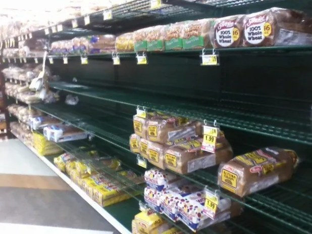 Kathi sent in another photo which confirms that Wake Forest residents are irrational when it comes to buying bread for a snow storm, but frugal. The cheap bread is cleaned out.