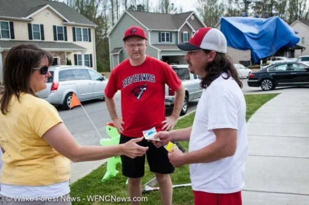 Rebecca and Dwyane Jenks bring over gift certificates to help from the girls softball team Scott coaches in Rolesville.