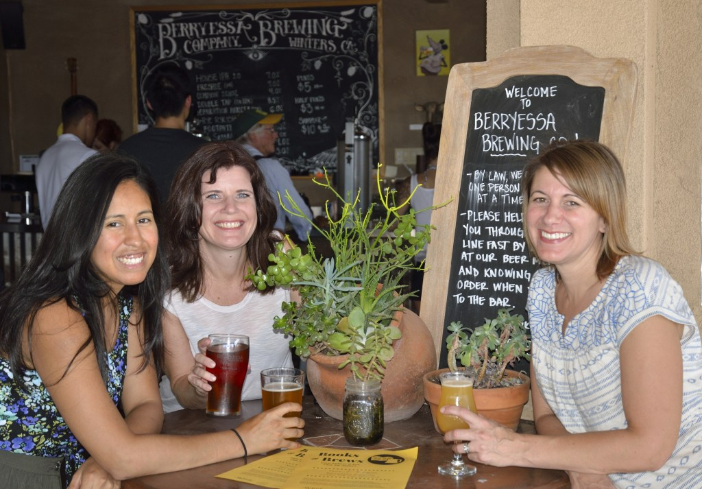 Board Member Bianca Cox, Author Tamsen Schultz and Brewery owner Lori are ready to greet you at Books and Brews.