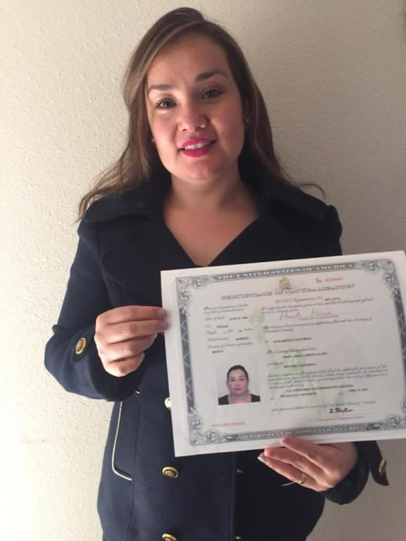 Maria Molina with citizenship certificate.