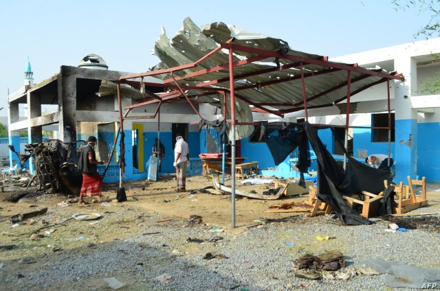 FILE - Yemeni workers clean a hospital operated by Doctors Without Borders (MSF) in Abs, in the rebel-held northern province of Hajja, after the hospital was allegedly hit by an airstrike by the Saudi-led coalition, Aug. 16, 2016.