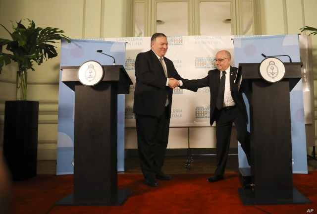 U.S. Secretary of State Mike Pompeo, left, and Argentine Foreign Minister Jorge Faurie, shakes hands during a press conference at an international counterterrorism conference in Buenos Aires, Argentina, Friday, July 19, 2019. (AP Photo/Natacha…