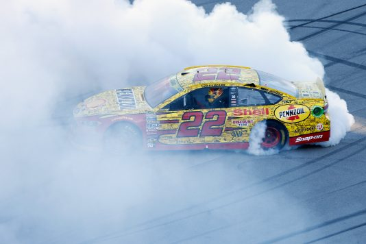 TALLADEGA, AL - OCTOBER 23:  Joey Logano, driver of the #22 Shell Pennzoil Ford, celebrates with a burnout after winning the NASCAR Sprint Cup Series Hellmann's 500 at Talladega Superspeedway on October 23, 2016 in Talladega, Alabama.  (Photo by Brian Lawdermilk/Getty Images)