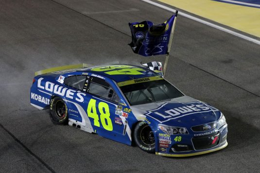 HOMESTEAD, FL - NOVEMBER 20:  Jimmie Johnson, driver of the #48 Lowe's Chevrolet, celebrates after winning the NASCAR Sprint Cup Series Ford EcoBoost 400 and the 2016 NASCAR Sprint Cup Series Championship at Homestead-Miami Speedway on November 20, 2016 in Homestead, Florida. Johnson wins a record-tying 7th NASCAR title.  (Photo by Sean Gardner/NASCAR via Getty Images)