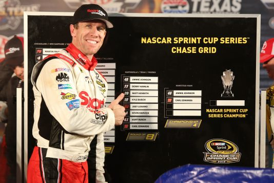 FORT WORTH, TX - NOVEMBER 06:  Carl Edwards, driver of the #19 Sport Clips Toyota, points to the Championship Round of the Chase Grid in Victory Lane after winning the rain-shortened NASCAR Sprint Cup Series AAA Texas 500 at Texas Motor Speedway on November 6, 2016 in Fort Worth, Texas.  (Photo by Jerry Markland/Getty Images)
