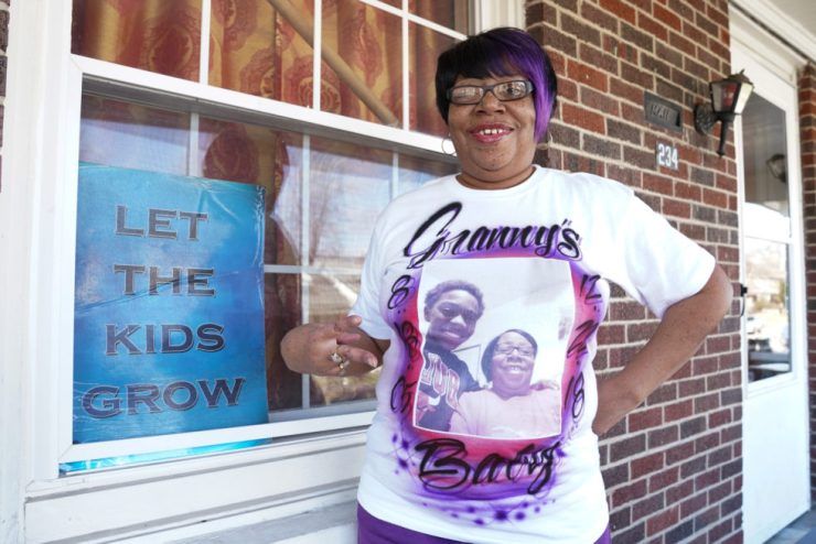 Ernestine Tyus poses outside with a shirt comemorating Ki'Anthony
