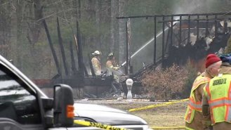 Crews worked to put out the flames in Griswold last Wednesday (WFSB)