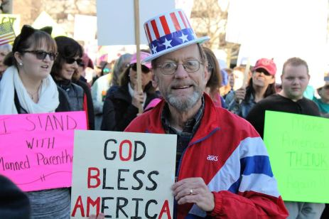 Substitute teacher Ron Zager marches down Market Street during the women's march on Jan. 21 in downtown St. Louis. Photo by Bennett Durando