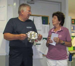 Honorary Member Maria Esther Bueno presents the Peter Risdon perpetual cup to the Chairman