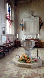 Chapel containing a moving tribute to the fallen in war, with the baptismal font in the foreground.