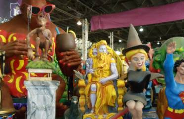 Mardi Gras World, also known as Blaine Kern's Mardi Gras World, is a tourist attraction located in New Orleans. Here guests can tour the 300,000-square-foot warehouse where the floats are made for the various Mardi Gras parades in New Orleans. Their River City Complex is also an events venue which hosts festivals, weddings, and private parties.