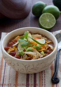 Chicken Tortilla Soup is a great way to stretch leftover rotisserie chicken, feeding your family dinner for a second night! | Recipe on WhatAGirlEats.com