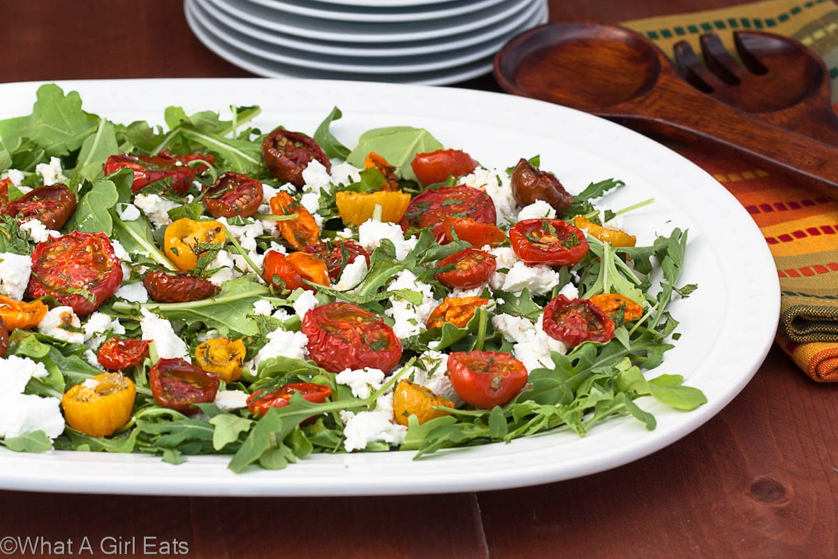Moonblush Tomato Salad is the perfect light meal, using fresh garden tomatoes, healthy arugula, mint, and creamy goat cheese!   from @whatagirleats