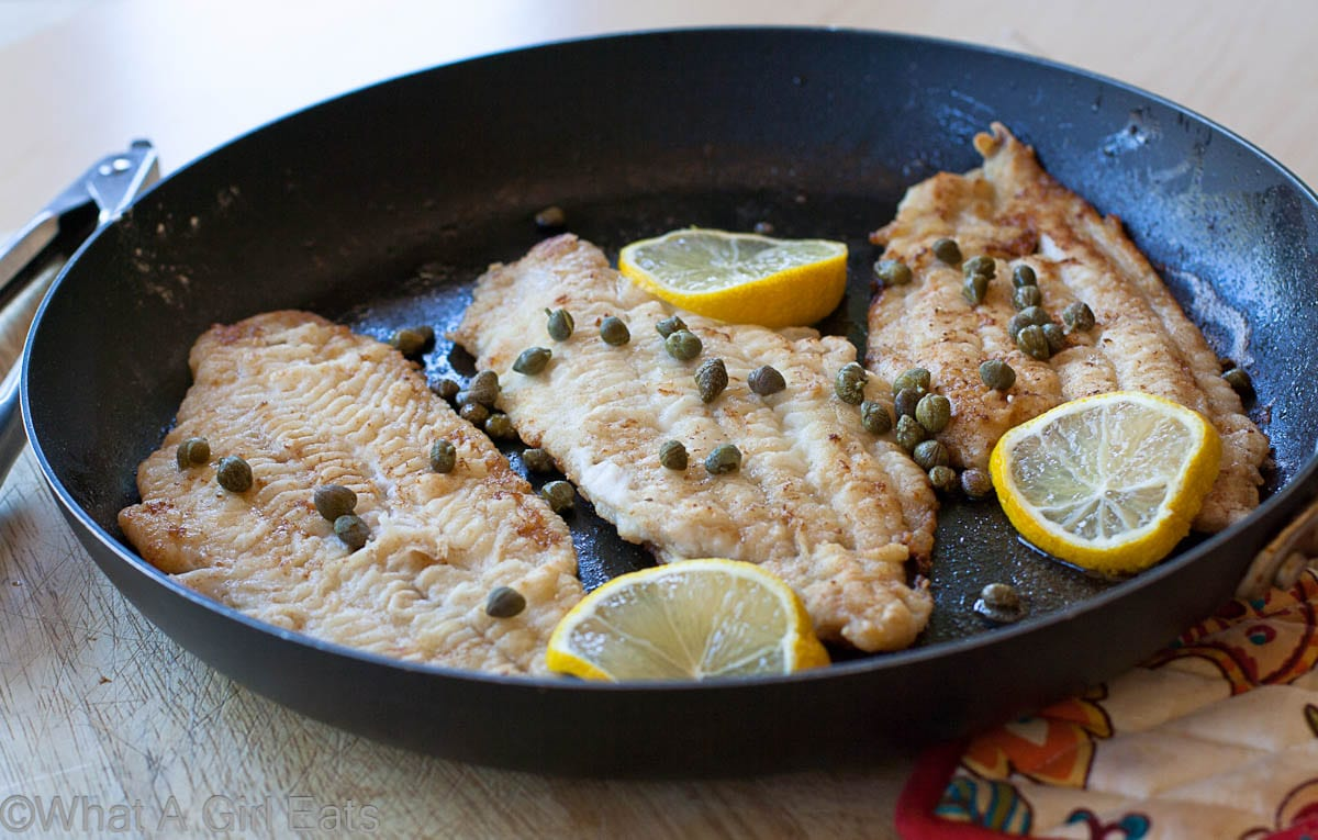 sole in a cast iron skillet with capers and lemon