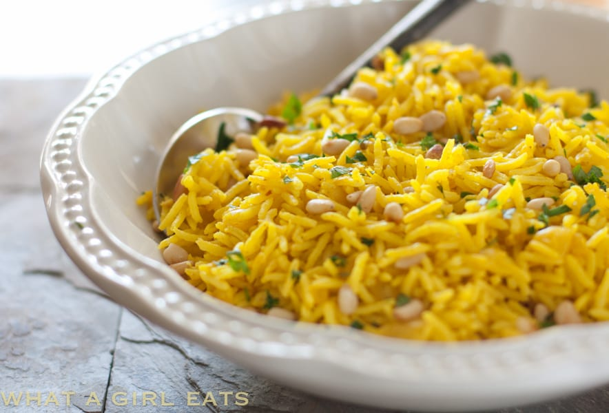 Easy and delicious Golden Rice Pilaf - A healthy Mediterranean side dish, flavored with tumeric and pine nuts.
