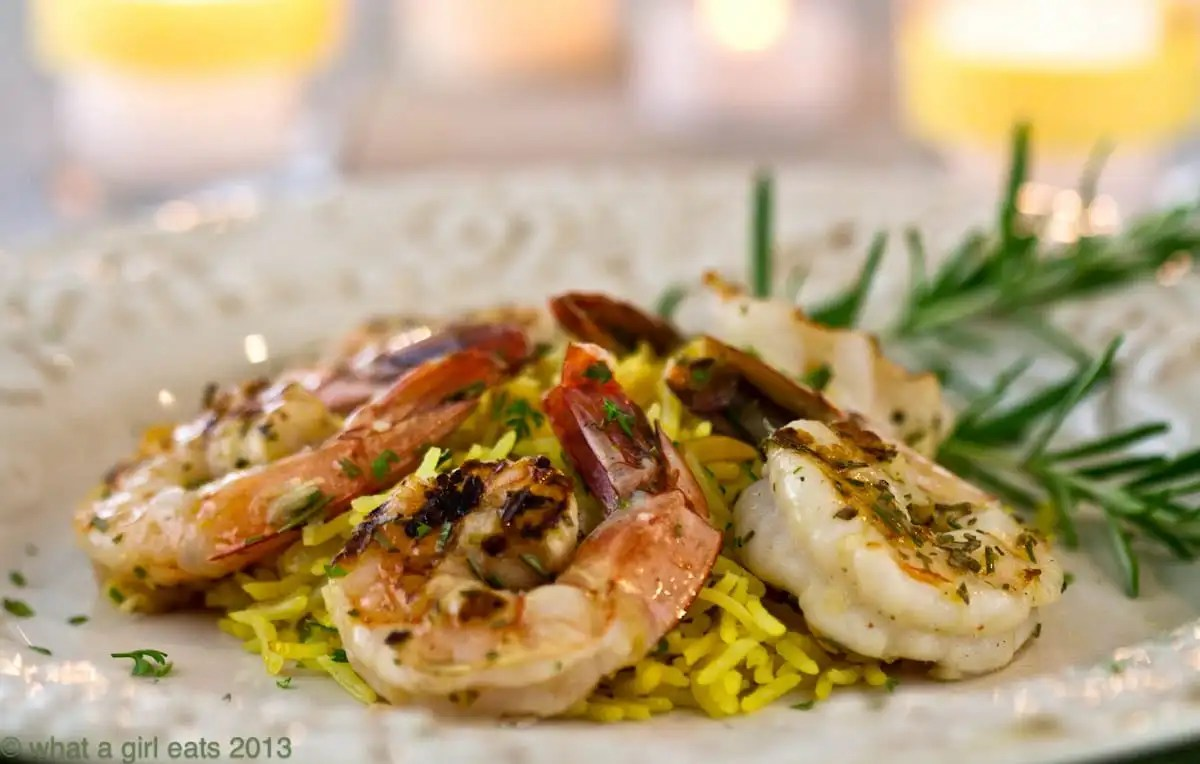 Grilled rosemary shrimp rice pilaf is an easy dinner recipe to make. Large shrimp, marinated with fresh rosemary and grilled, served with tender rice pilaf.   @whatagirleats