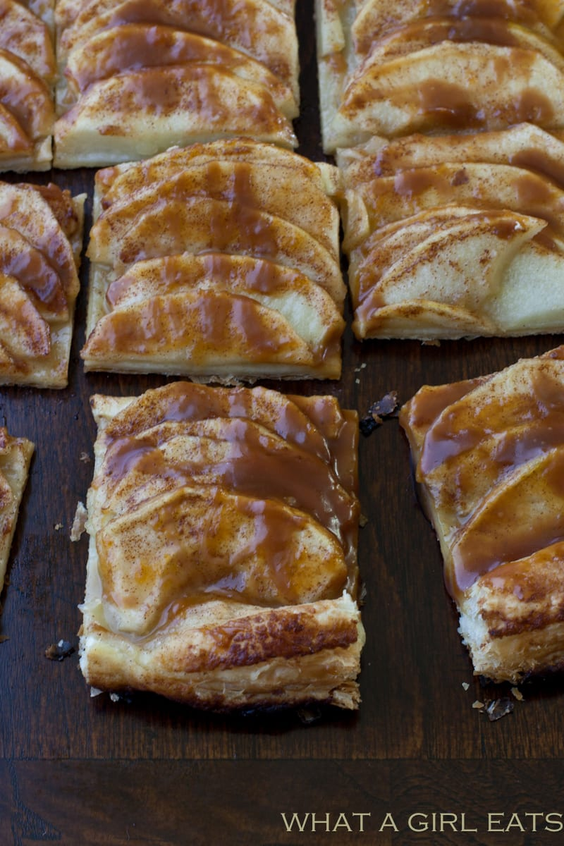 Caramel apple tart is comprised of tart apples and creamy liquid caramel, baked inside of a puff pastry crust.