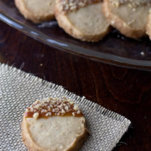 Caramel dipped walnut shortbread acorn cookies.