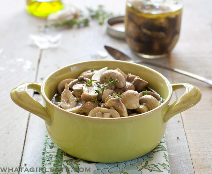 Simple marinated mushrooms are just that - Mushrooms marinated in white wine, vinegar, herbs and garlic. Get the recipe from WhatAGirlEats.com