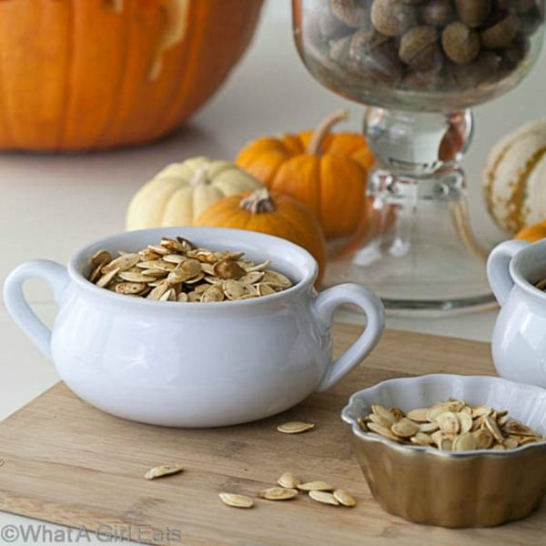 Part of the Halloween fun is roasting pumpkin seeds! Roasted Pumpkin Seeds with Wasabi - Get the recipe from WhatAGirlEats.com