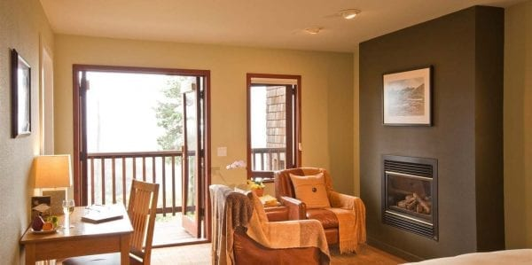 Our room with cozy sitting area, fireplace and deck overlooking Smuggler's Cove.