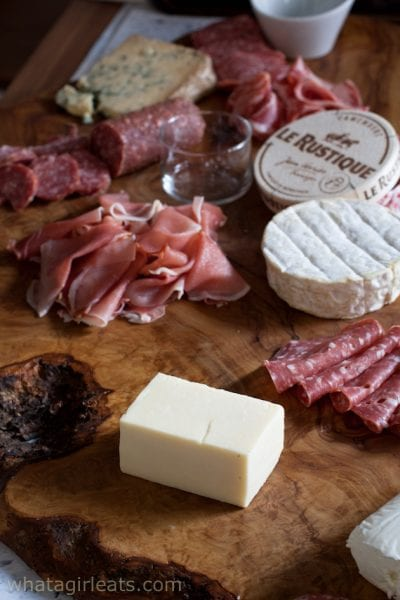 placing the cheese on a charcuterie board