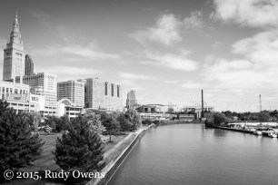 A sunny day makes the Cuyahoga look almost scenic; to the left the Terminal Tower.