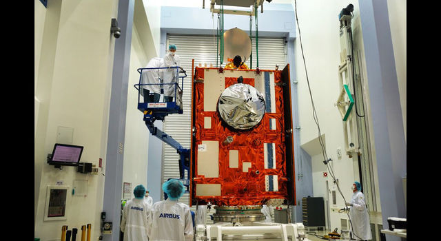 slide 2 - The Sentinel-6 Michael Freilich satellite sits in front of a testing chamber
